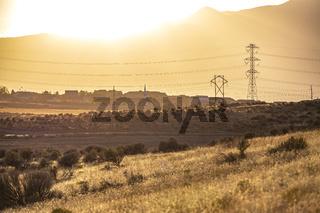 Bright sun setting behind mountain in Utah Valley