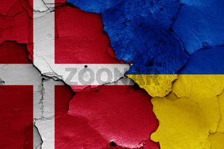 flags of Denmark and Ukraine painted on cracked wall