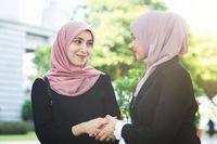 Muslim business women greeting