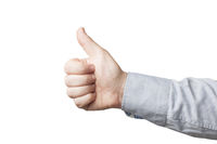 Close-up of business man in blue shirt showing thumb up, white background