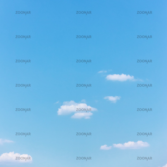 Light cyan blue sky with white clouds