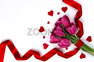 Tulip flowers and hearts on white