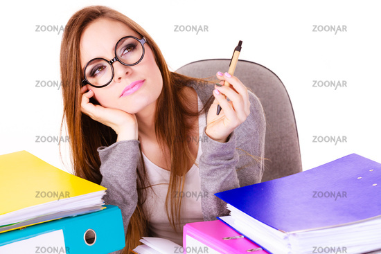 Woman sitting at desk in office and thinking