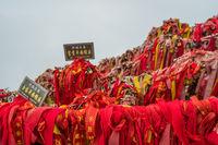 Red ribbons and padlocks along trail on Huashan Mountain