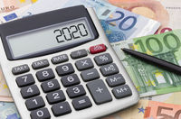 Calculator with money and a pen - 2020