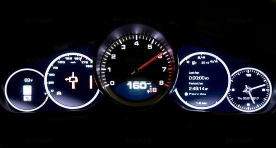 Modern light car mileage on black background