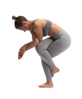 Woman practicing yoga in a studio isolated on a white background