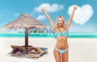 happy young woman in bikini doing fist pump