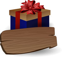 Holiday blue gift box with bow and wooden board for inscriptions
