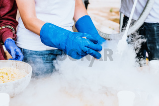 Pouring liquid nitrogen with protective glove.