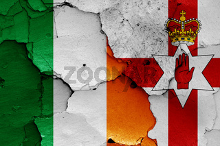 flags of Ireland and Northern Ireland painted on cracked wall