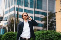 The Businessman Went Outside For A Break To Enjoy A Warm Day And To Talk On The Phone With An Investor