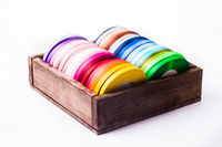 Color ribbon bobbins in the vintage box