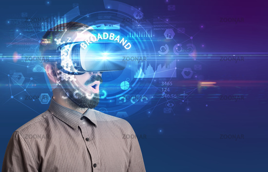 Businessman looking through VR glasses