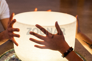 Couple holding a crystal bowl together