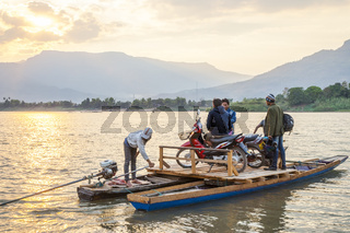 Transporting motorbikes over Mekong, Laos