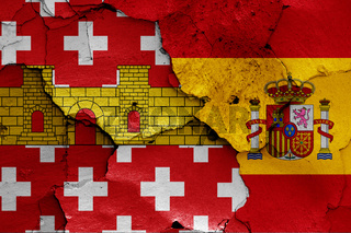 flags of Regencos and Spain painted on cracked wall