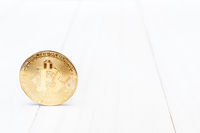 Bitcoin on white wooden background