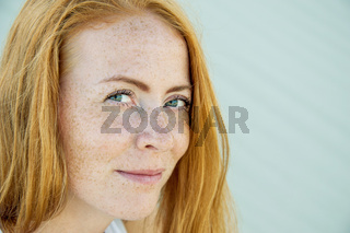 Young girl with red hair and freckles.