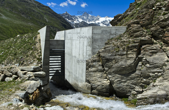 Passage with bar barrier, protective structure against mud avalanches and landslides, Swiss Alps