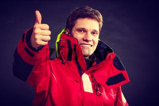 Cheerful man with weatherproof gear
