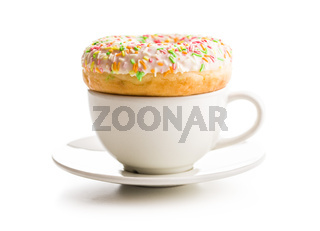 Sweet donut and coffee cup.