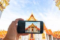 Camera phone with Thai Marble Temple (Wat Benchamabophit Dusitvanaram) in Bangkok, Thailand