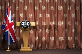 Podium speaker tribune with flags of Great Britain and UK coat of arms. Briefing or press conference of prime minister or queen of UK  Great Britain.