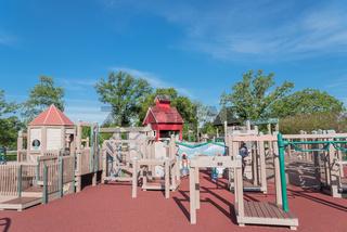 Children wooden playground recreation area with soft surfacing