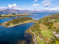 Aerial of secret beach by Portnacroish in autumn, Argyll, Scotland, UK
