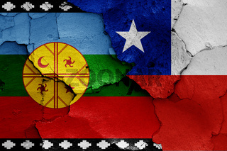 flags of Mapuche and Chile painted on cracked wall