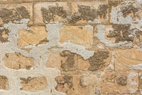 Background weathered Mediterranean stone wall