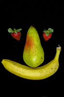 Smiling fruit face with strawberry eyes