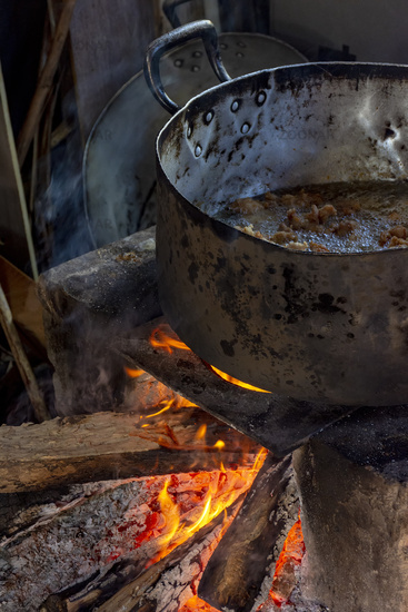 Old wood burning stove with big pan in a dirty kitchen
