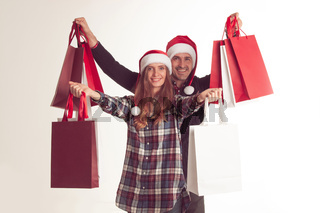 Couple holding christmas shopping bags