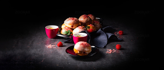 Delicious Berlin donuts filled with raspberry jam