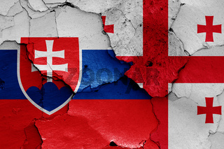 flags of Slovakia and Georgia painted on cracked wall