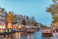 Canal of Amsterdam during blue hour in autumn time