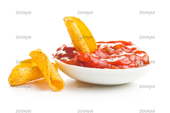 Rolled mexican nacho chips and salsa dip