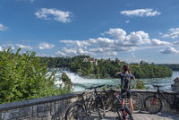 Bikers at the lookout point in front of the Rhine Falls with the
