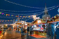 Moscow, Russia, 05 December 2017: Christmas market. Christmas on red square. Kremlin. Kremlin wall. The city is decorated with garlands. Christmas carousel on red square. Winter impressions of Russia