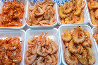 Tapas with shrimps seen at a market in Madrid, Spain