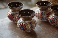 Turkish handmade symbolic ceramic cups on wooden background. Ceramic traditional turkish souvenir pots at Grand bazaar, istanbul