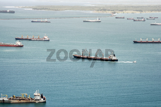 Aerial view of large cargo ships waiting at Gatun Lake to pass through Panama Canal