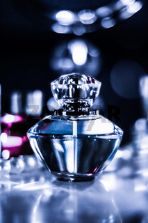 Perfume bottle and vintage fragrance on glamour vanity table at night, pearls jewellery and eau de parfum as holiday gift, luxury beauty brand present