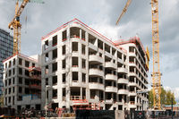 new apartment building under construction - real estate development