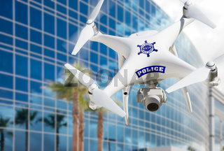 Police Unmanned Aircraft System, (UAS) Drone Flying Near City Highrise Building