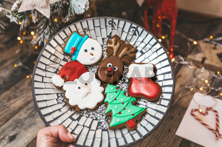 A plate of festive shaped gingerbread at Christmas time