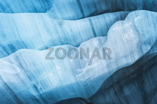 Close-up the ceiling of an ice grotto in a crumbling glacier. Textured background. Global warming. Small DOF