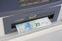 Some euro banknotes dispensed from an ATM machine (bancomat)
